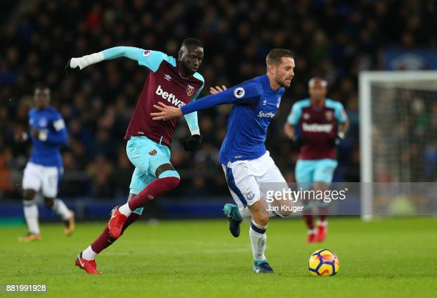 Gylfi Sigurdsson of Everton is challenged by Cheikhou Kouyate of West Ham United during the Premier League match between Everton and West Ham United...