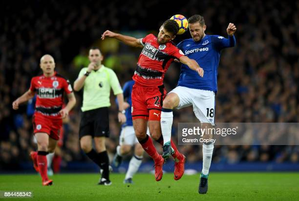 Gylfi Sigurdsson of Everton is challenged by Tommy Smith of Huddersfield Town during the Premier League match between Everton and Huddersfield Town...