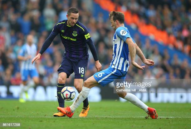 Gylfi Sigurdsson of Everton is tackled by Dale Stephens of Brighton and Hove Albion during the Premier League match between Brighton and Hove Albion...