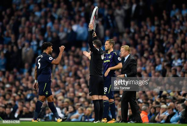 Gylfi Sigurdsson of Everton replaces Ashley Williams of Everton to make his club debut during the Premier League match between Manchester City and...