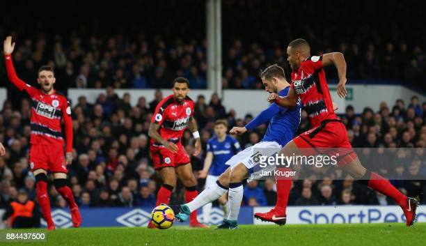 Gylfi Sigurdsson of Everton scores his sides first goal during the Premier League match between Everton and Huddersfield Town at Goodison Park on...