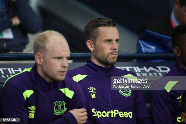 Gylfi Sigurdsson of Everton sits on the bench as substitute during the Premier League match between Manchester City and Everton at Etihad Stadium on...