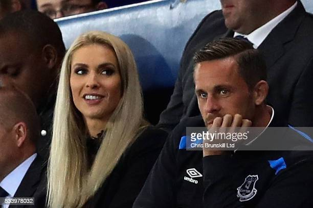 Gylfi Sigurdsson of Everton watches the match with partner Alexandra Ivarsdottir during the UEFA Europa League Qualifying PlayOffs round first leg...