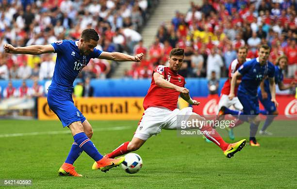 Gylfi Sigurdsson of Iceland crosses under presure from Aleksandar Dragovic of Austria during the UEFA EURO 2016 Group F match between Iceland and...