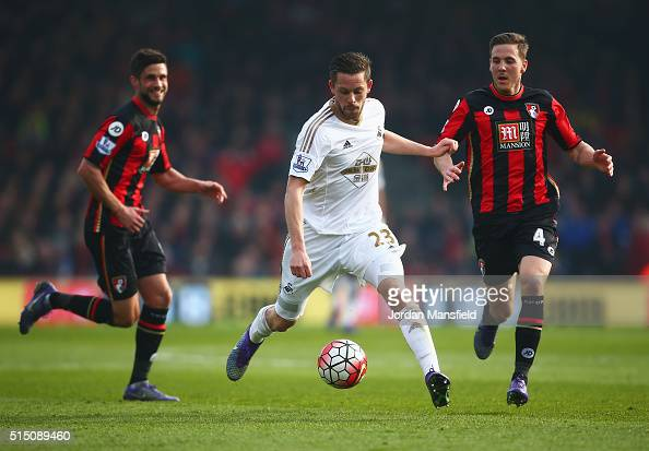 Gylfi Sigurdsson of Swansea City and Dan Gosling of Bournemouth compete for the ball during the Barclays Premier League match between AFC Bournemouth...