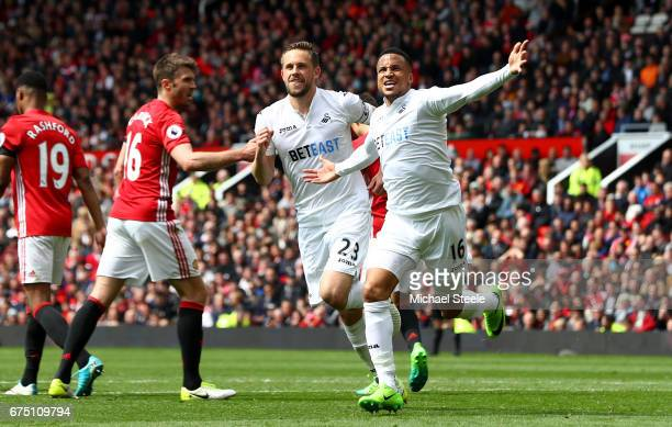 Gylfi Sigurdsson of Swansea City celebrates scoring his sides first goal with Martin Olsson of Swansea City during the Premier League match between...