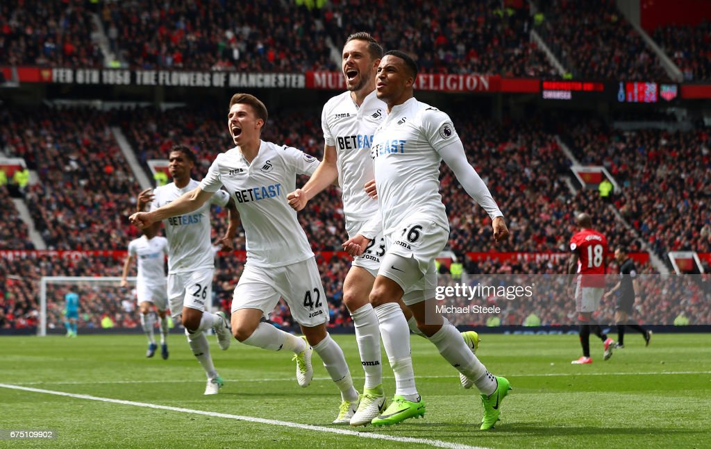 Gylfi Sigurdsson of Swansea City celebrates scoring his sides first goal with his Swansea City team mates during the Premier League match between Manchester United and Swansea City at Old Trafford on April 30, 2017 in Manchester, England.