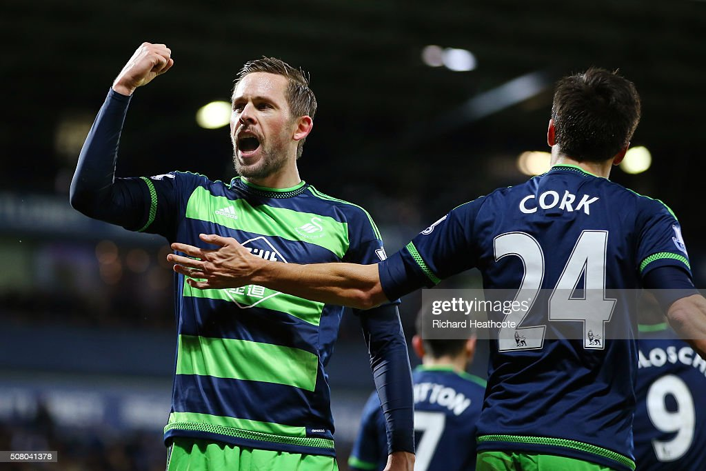 Gylfi Sigurdsson (L) of Swansea City celebrates scoring his team's first goal with his team mate Jack Cork (R) during the Barclays Premier League match between West Bromwich Albion and Swansea City at The Hawthorns on February 2, 2016 in West Bromwich, England.