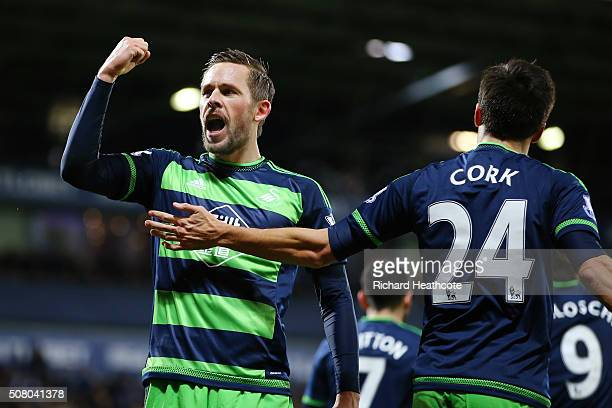 Gylfi Sigurdsson of Swansea City celebrates scoring his team's first goal with his team mate Jack Cork during the Barclays Premier League match...