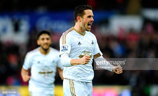 Gylfi Sigurdsson of Swansea City celebrates scoring his team's first goal during the Barclays Premier League match between Swansea City and Crystal...