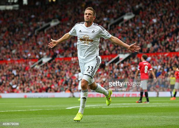 Gylfi Sigurdsson of Swansea City celebrates scoring his team's second goal during the Barclays Premier League match between Manchester United and...