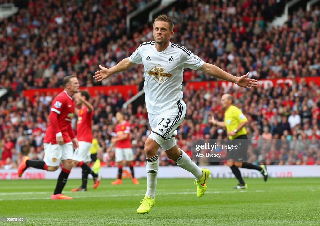 <a gi-track='captionPersonalityLinkClicked' href=/galleries/search?phrase=Gylfi+Sigurdsson&family=editorial&specificpeople=6401581 ng-click='$event.stopPropagation()'>Gylfi Sigurdsson</a> of Swansea City celebrates scoring his team's second goal during the Barclays Premier League match between Manchester United and Swansea City at Old Trafford on August 16, 2014 in Manchester, England.