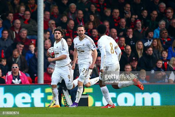 Gylfi Sigurdsson of Swansea City celebrates scoring his team's second goal with his team mate Alberto Paloschi and Leroy Fer during the Barclays...