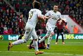 Gylfi Sigurdsson of Swansea City celebrates scoring his team's second goal with his team mate Alberto Paloschi during the Barclays Premier League...