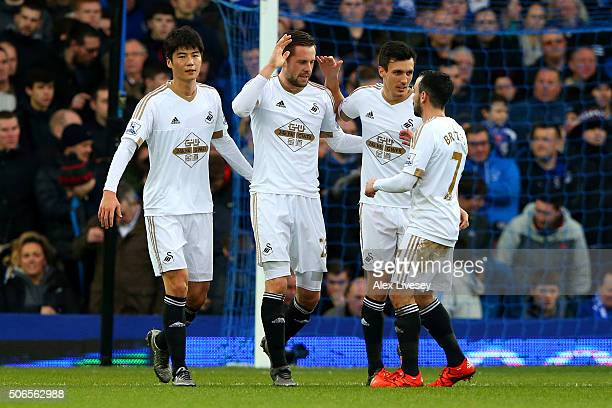 Gylfi Sigurdsson of Swansea City celebrates with teammates after scoring the opening goal from the penalty spot during the Barclays Premier League...