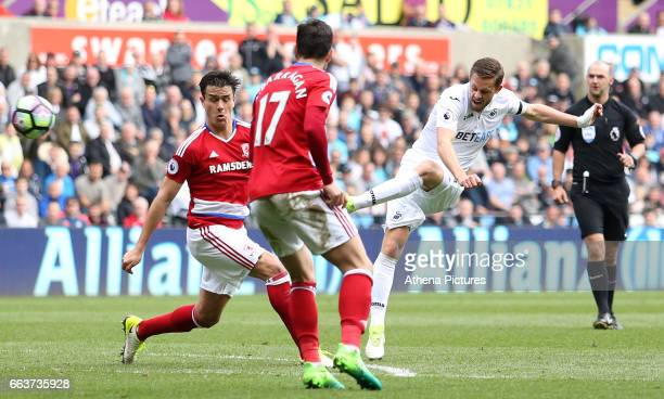 Gylfi Sigurdsson of Swansea City has a shot on goal during the Premier League match between Swansea City and Middlesbrough at The Liberty Stadium on...