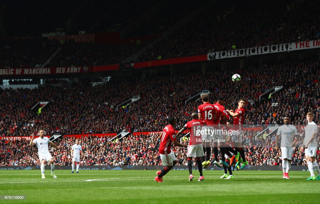 Gylfi Sigurdsson of Swansea City scores his sides first goal from a freekick during the Premier League match between Manchester United and Swansea City at Old Trafford on April 30, 2017 in Manchester, England.