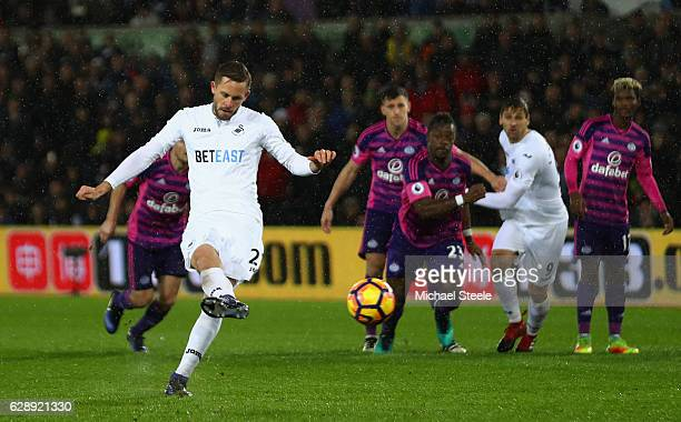 Gylfi Sigurdsson of Swansea City scores his sides first goal from the penalty spot during the Premier League match between Swansea City and...