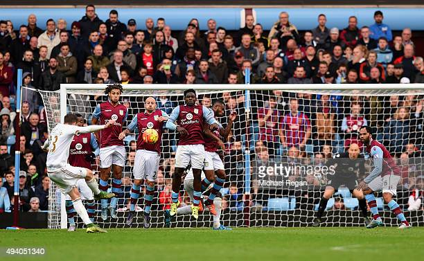 Gylfi Sigurdsson of Swansea City scores his team's first goal from a fee kick during the Barclays Premier League match between Aston Villa and...