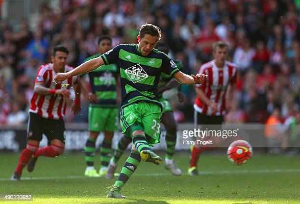 Gylfi Sigurdsson of Swansea City scores his team's first goal from the penalty spot during the Barclays Premier League match between Southampton and...