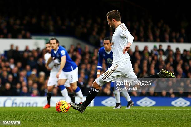 Gylfi Sigurdsson of Swansea City scores the opening goal from the penalty spot during the Barclays Premier League match between Everton and Swansea...
