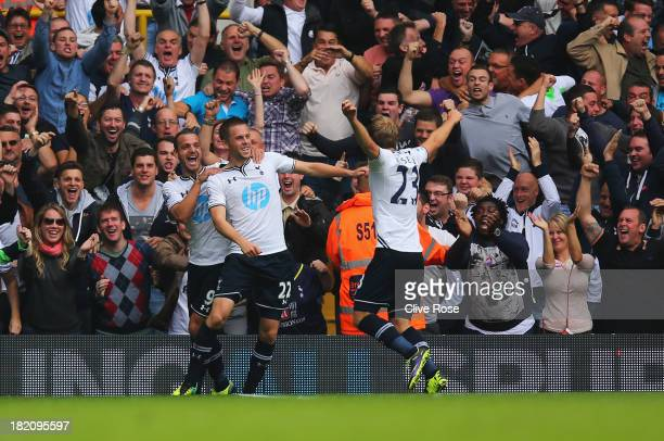 Gylfi Sigurdsson of Tottenham Hotspur celebrates in front of fans with Roberto Soldado and Christian Eriksen during the Barclays Premier League match...