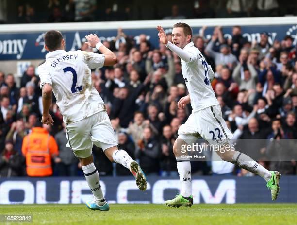 Gylfi Sigurdsson of Tottenham Hotspur celebrates scoring their second goal with Clint Dempsey of Tottenham Hotspur during the Barclays Premier League...