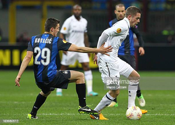 Gylfi Sigurdsson of Tottenham Hotspur competes for the ball with of Mateo Kovacic FC Internazionale Milano during the UEFA Europa League Round of 16...