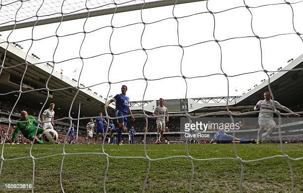 Gylfi Sigurdsson of Tottenham Hotspur scores their second goal during the Barclays Premier League match between Tottenham Hotspur and Everton at...
