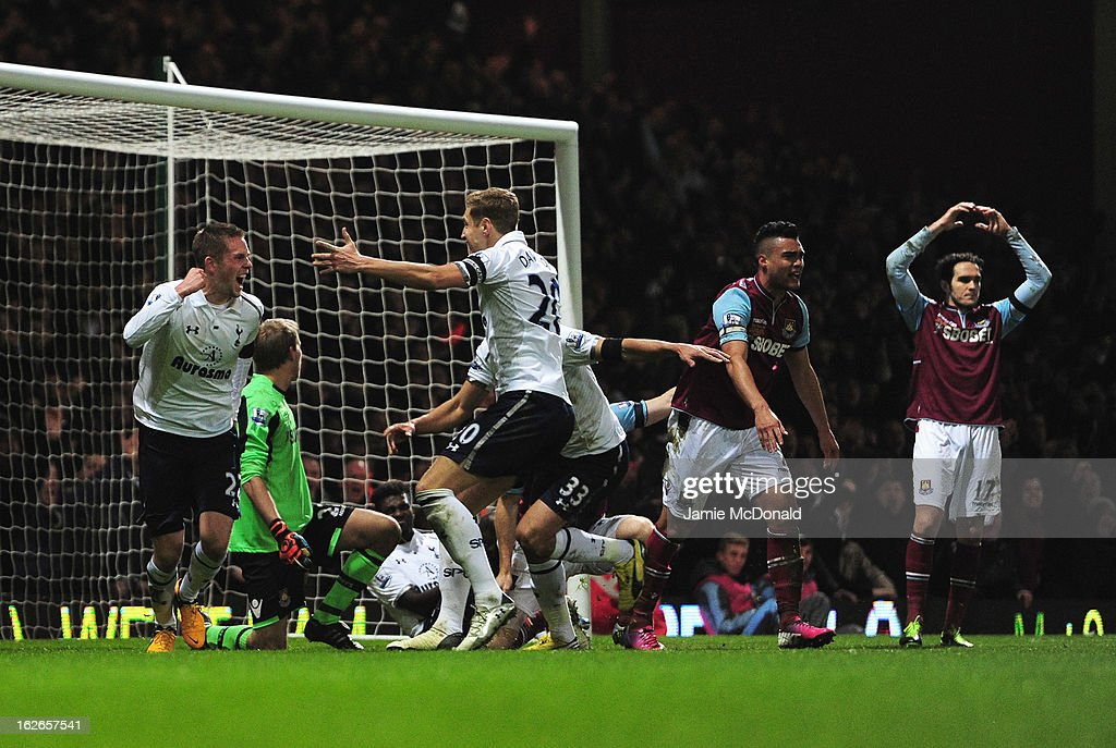 Gylfi Sigurdsson (L) of Tottenham Hotspur turns away to celebrate his goal with team mates during the Barclays Premier League match between West Ham United and Tottenham Hotspur at the Boleyn Ground on February 25, 2013 in London, England.