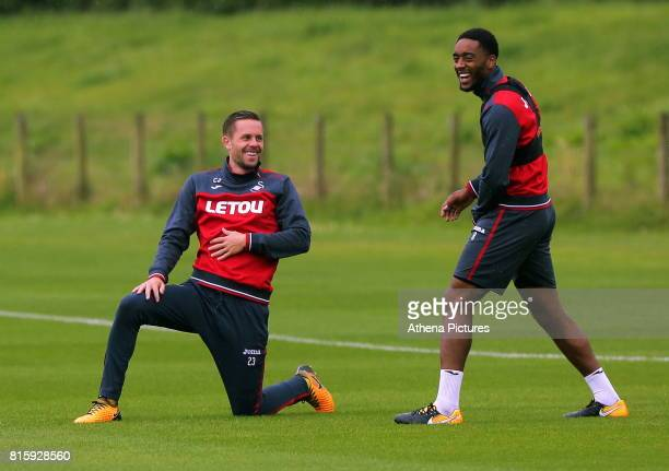 Gylfi Sigurdsson stretches with Leroy Fer during the Swansea City Training at The Fairwood Training Ground on July 11 2017 in Swansea Wales