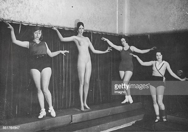 Gym class with fashion dolls in a Berlin ballet school Copy of hand gestures of a fashion doll About 1930 Photograph