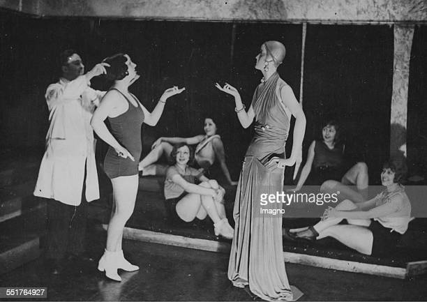 Gym class with fashion dolls in a Berlin ballet school Copy the head pose and hand gesture About 1930 Photograph