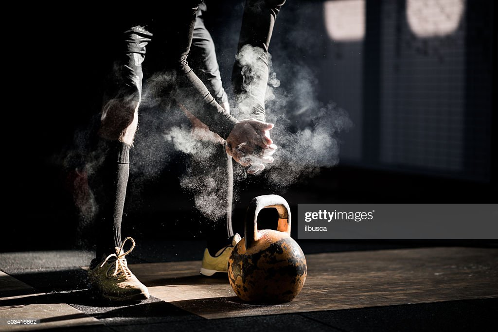 Gym fitness workout: Man ready to exercise with kettle bell : Stock Photo