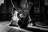 A gym kettle bell is best used with chalked up hands to prevent slipping as you work hard and sweat hard.