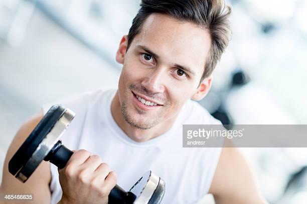 Gym man lifting weights