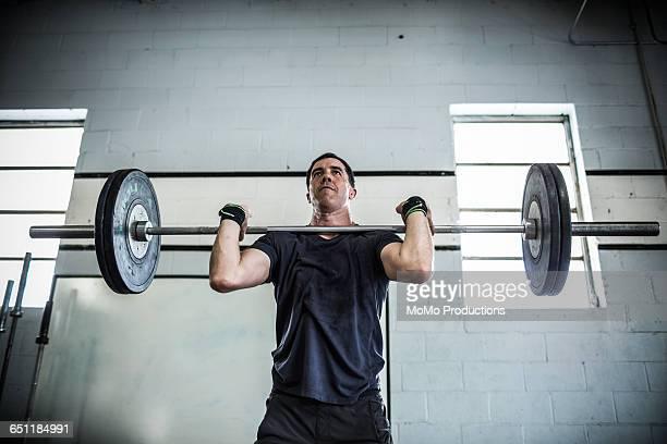 gym - man lifting weights