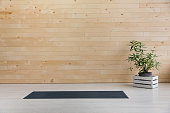 Yoga mat on a wooden background. Equipment for yoga. Concept healthy lifestyle