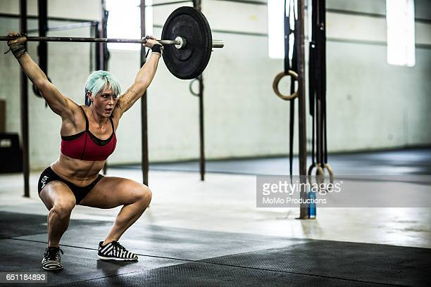 gym - woman doing overhead squats