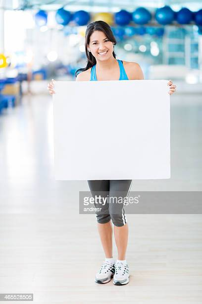 Gym woman holding a banner