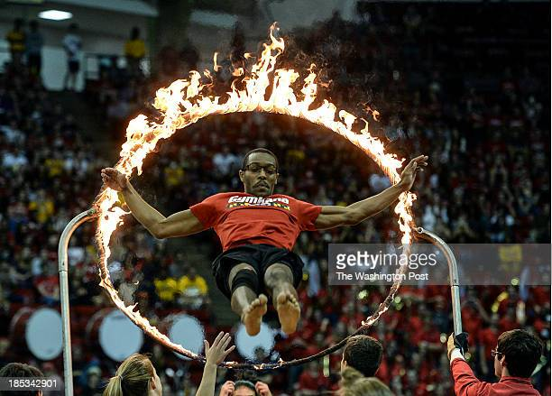 Gymkana team member vaults through the 'Ring of Fire' while preforming during Maryland Madness the kickoff event for the Terps' basketball teams at...