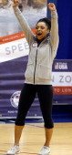 Gymnast and Olympic gold medal winner Dominique Dawes cheers during an Olympicsthemed event with area school children at American University March 13...