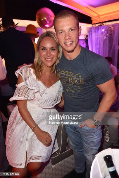 Gymnast and Olympic gold medalist champion Fabian Hambuechen and Kathi Woerndl during the H'ugo's 10th birthday celebration party at Hugo's on July...