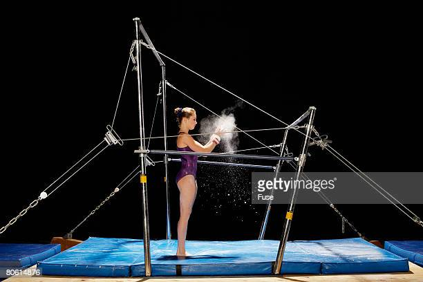 Gymnast Chalking Up Hands for Uneven Parallel Bars