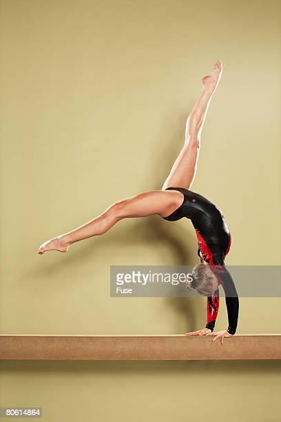 Gymnast Doing Back Flip on the Balance Beam