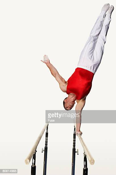 Gymnast Doing One Armed Handstand