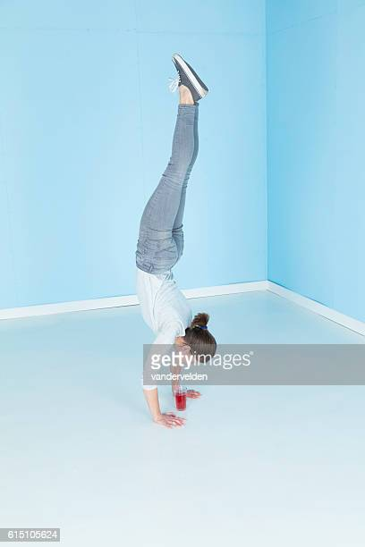Gymnast Drinking Whilst Standing On Her Hands