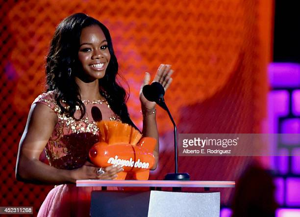 Gymnast Gabby Douglas accepts the Best Female Athlete Award onstage during Nickelodeon Kids' Choice Sports Awards 2014 at UCLA's Pauley Pavilion on...
