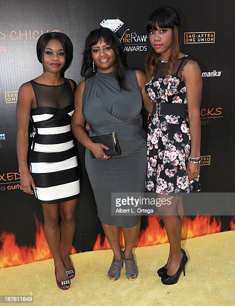 Gymnast Gabby Douglas with mother and sister arrive for the 6th Annual Diamond In The RAW Action Icon Awards held at Skirball Cultural Center on...