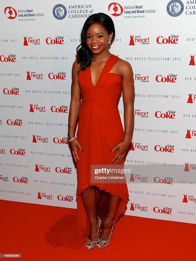 Gymnast Gabrielle Douglas attends The Heart Truth's Red Dress Collection Fall 2013 Mercedes-Benz Fashion Show at 499 Seventh Avenue on February 6, 2013 in New York City.